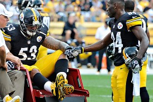 Pouncey being carted off the field
