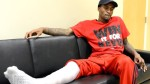 Ware sits with his full leg cast